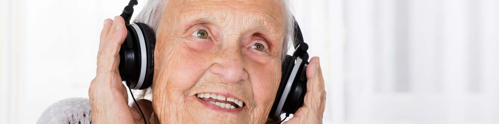 Alzheimer's patient enjoying music - Browse the Alzheimer's Store - The best simple music players and easy to use music related products for those with Alzheimer's, Dementia, Stroke, Memory Loss and for Senior Care